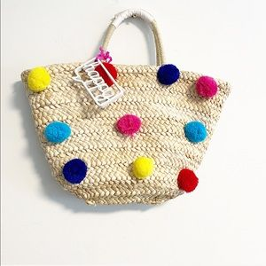 Straw woven 'happy' spring / summer tote poms